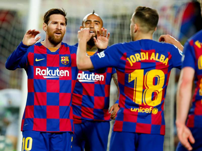 Barcelona's Jordi Alba, right, celebrates with Barcelona's Lionel Messi before the goal he scored was disallowed after a VAR decision during a Spanish La Liga soccer match between Barcelona and Real Sociedad at the Camp Nou stadium in Barcelona, Spain, Saturday, March 7, 2020. (AP Photo/Joan Monfort)