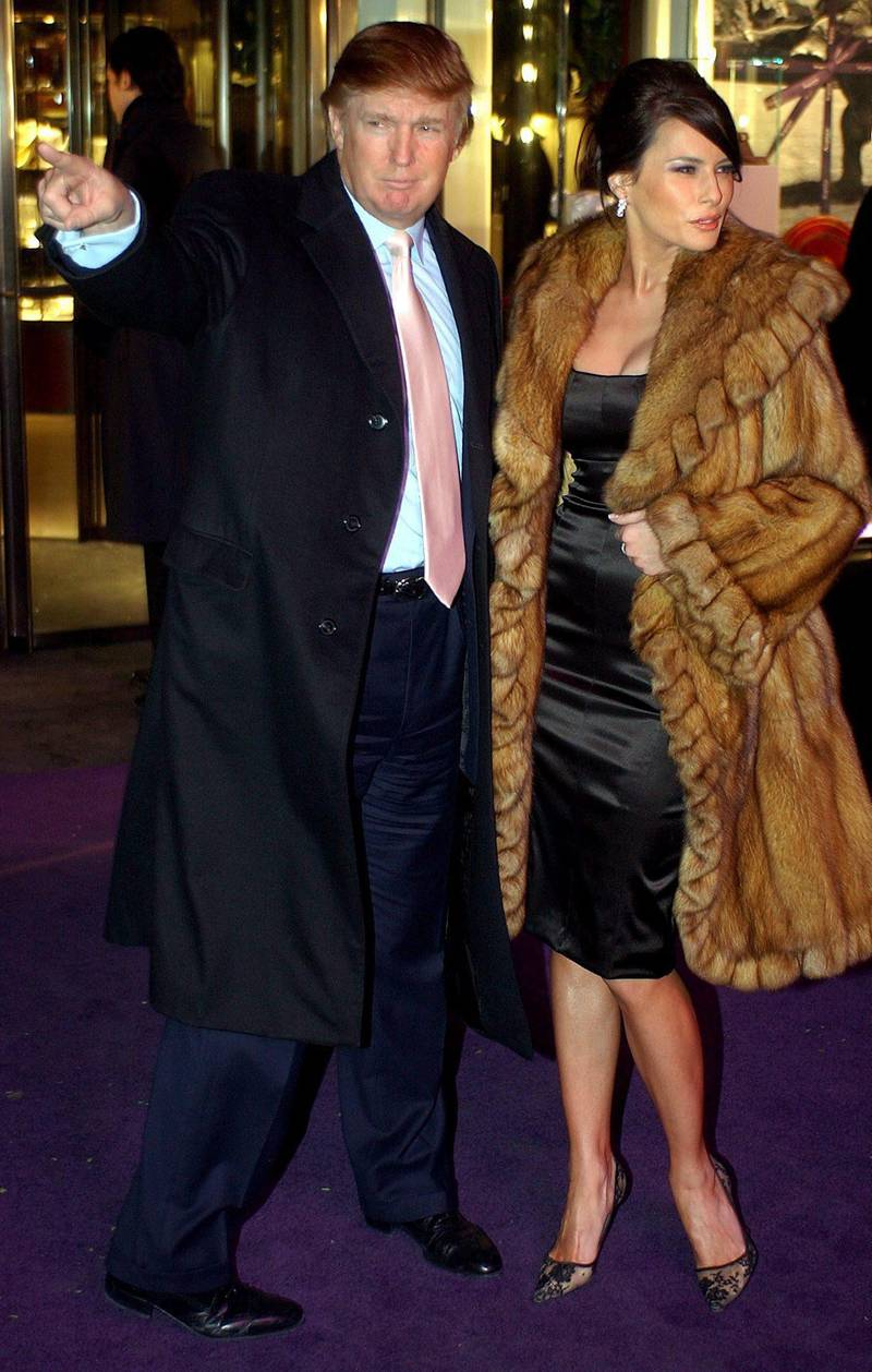 epa000247909 (FILES) Real Estate Developer Donald Trump (L) and girlfriend Melania Knauss stand in front of the new Asprey flagship store in New York City Monday 08 December 2003 during the store's opening celebration.  Key investors in the casino holding company have pushed Donald Trump aside and plan to take the company into bankruptcy, news reports said Tuesday, 10 August 2004. Trump will lose his title as chief executive officer of the Trump Hotel & Casino Resorts Inc. but will remain chairman, the reports said quoting the company.  EPA/Justin Lane