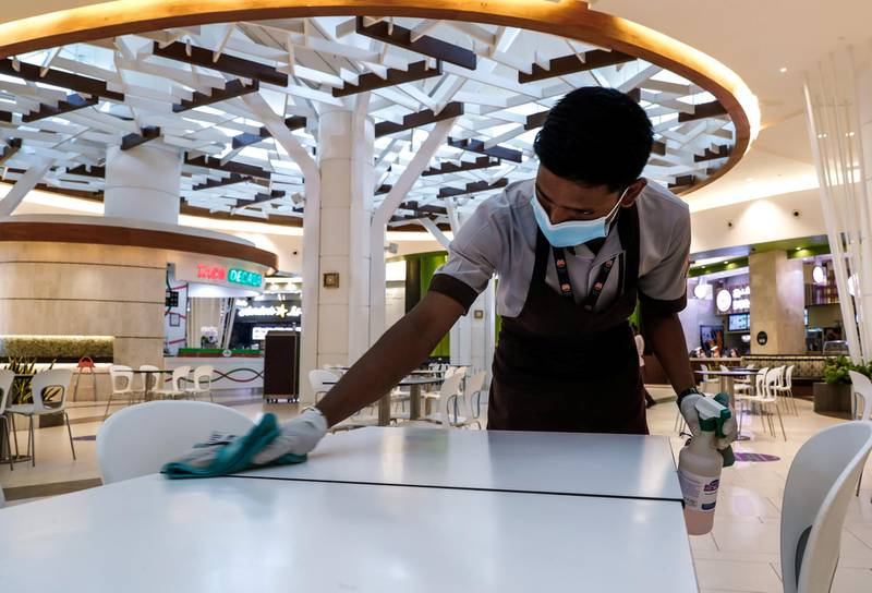 Abu Dhabi, United Arab Emirates, August 19, 2020.  Yas Mall cleaners at the food court.Victor Besa /The NationalSection:  NAReporter:  Haneen Dajani