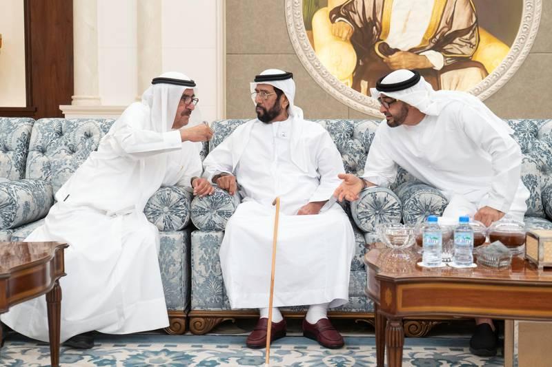 ABU DHABI, UNITED ARAB EMIRATES - November 21, 2019: HH Sheikh Hamdan bin Rashid Al Maktoum, Deputy Ruler of Dubai and UAE Minister of Finance (L), offers condolences to HH Sheikh Tahnoon bin Mohamed Al Nahyan, Ruler's Representative in Al Ain Region (C) and HH Sheikh Mohamed bin Zayed Al Nahyan, Crown Prince of Abu Dhabi and Deputy Supreme Commander of the UAE Armed Forces (R) on the passing of the late HH Sheikh Sultan bin Zayed Al Nahyan, at Al Mushrif Palace.  ( Rashed Al Mansoori / Ministry of Presidential Affairs ) ---