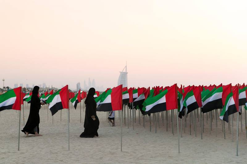DUBAI, UNITED ARAB EMIRATES - NOV 2:Visitors of Flag Garden at Kite Beach.(Photo by Reem Mohammed/The National)Reporter: Section: NA FLAG DAY