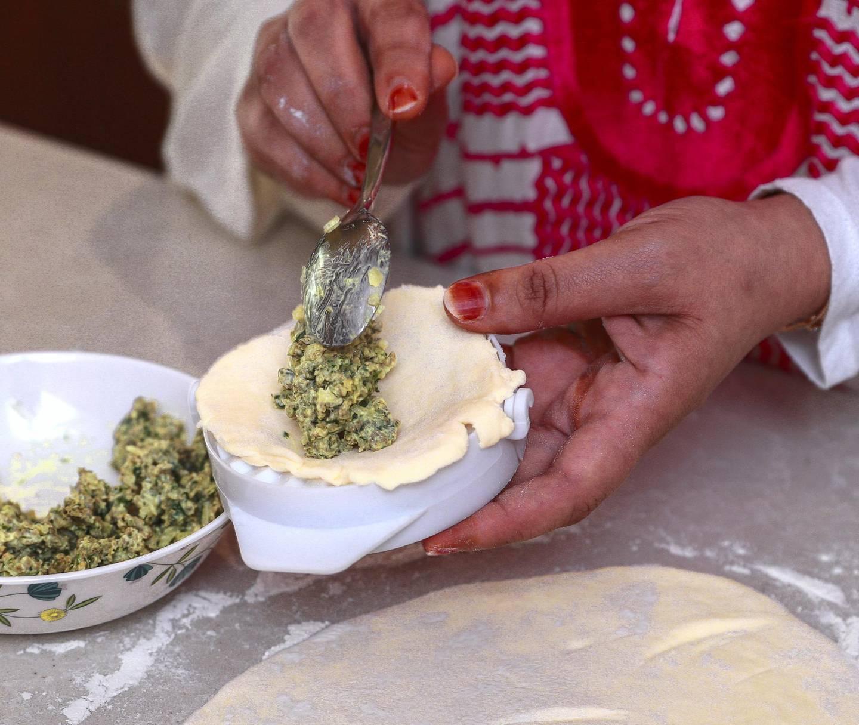 Abu Dhabi, United Arab Emirates, April 12, 2021.  Ramadan Recipes.  Ramadan dishes by Ashwaq Abdolmonem.  Sambousek puffVictor Besa/The NationalSection:  ACReporter:  Hanan Sayed Worrell