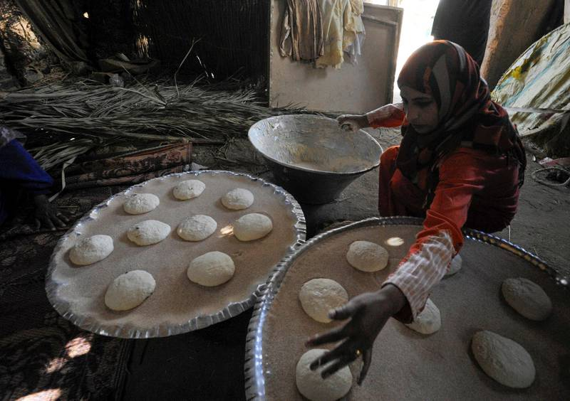 A woman prepares bread for sale to incoming tourists to improve her living conditions in a village at Saqqara, near Giza, Egypt, April 27, 2021. Picture taken April 27, 2021. REUTERS/Shokry Hussien