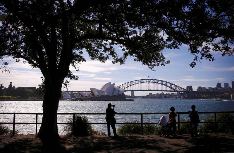 Tourists take photographs as they stand in front of the Sydney Harbour Bridge and Sydney Opera House in Australia, November 13, 2018.    REUTERS/David Gray