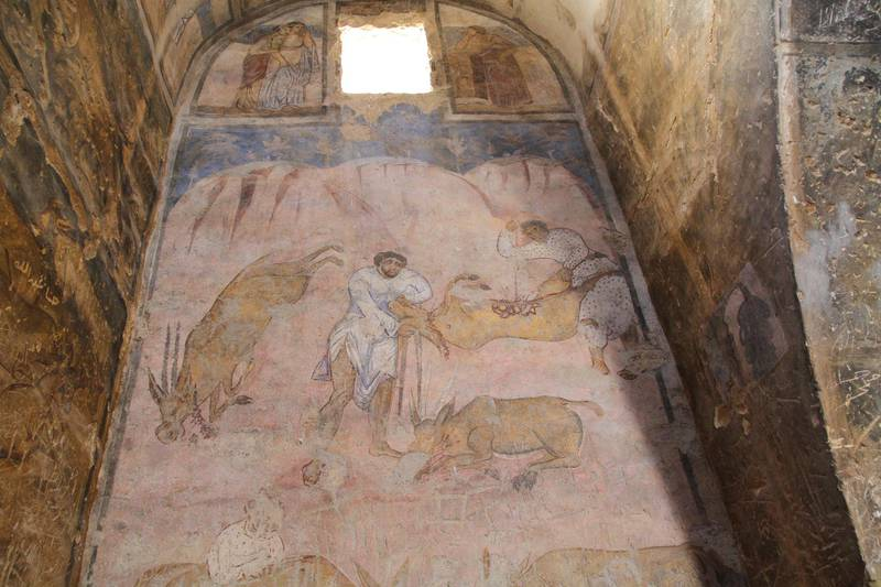 Colourful paintings depicting daily life were  restored by Italian archaeologists. Amy McConaghy / The National