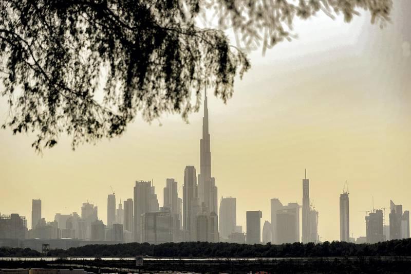 Dubai, United Arab Emirates - Reporter: N/A: Standalone / Weather. The sun sets behind the Dubai skyline. Tuesday, May 26th, 2020. Dubai. Chris Whiteoak / The National