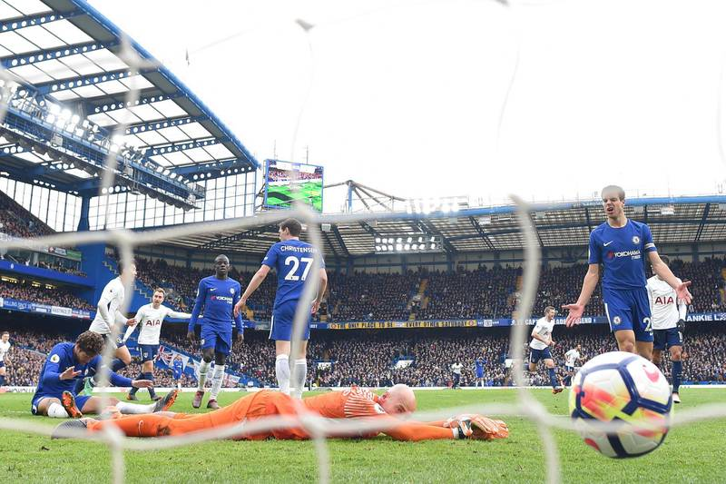 LONDON, ENGLAND - APRIL 01: Willy Caballero of Chelsea reacts as Dele Alli of Tottenham Hotspur scores his sides third goal during the Premier League match between Chelsea and Tottenham Hotspur at Stamford Bridge on April 1, 2018 in London, England.  (Photo by Michael Regan/Getty Images)