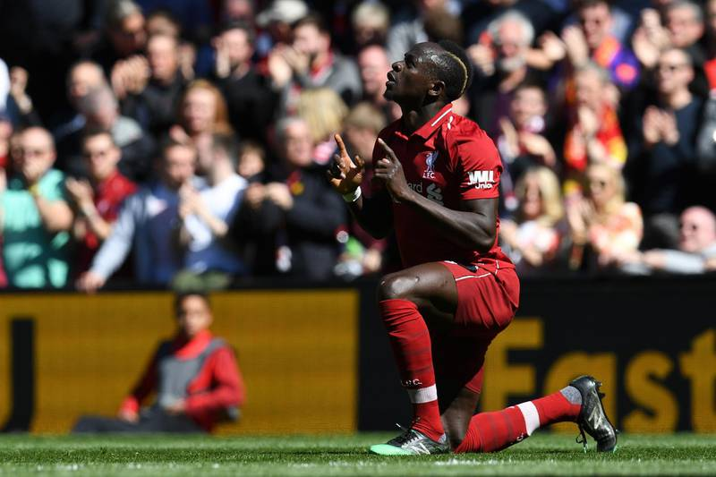 Liverpool's Senegalese striker Sadio Mane celebrates scoring the opening goal during the English Premier League football match between Liverpool and Wolverhampton Wanderers at Anfield in Liverpool, north west England on May 12, 2019. (Photo by Paul ELLIS / AFP) / RESTRICTED TO EDITORIAL USE. No use with unauthorized audio, video, data, fixture lists, club/league logos or 'live' services. Online in-match use limited to 120 images. An additional 40 images may be used in extra time. No video emulation. Social media in-match use limited to 120 images. An additional 40 images may be used in extra time. No use in betting publications, games or single club/league/player publications. /