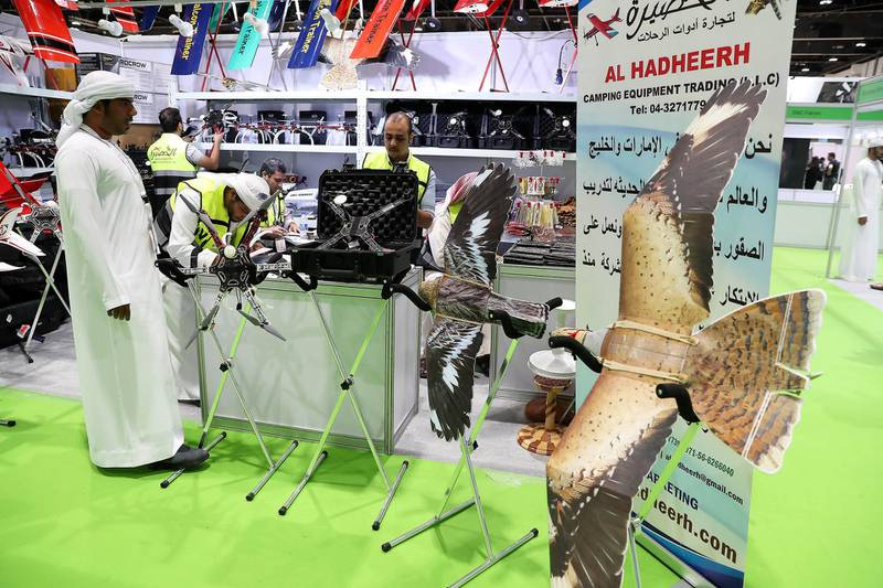 ABU DHABI ,  UNITED ARAB EMIRATES , AUGUST 27 – 2019 :- Visitors looking at the hunting items during the ADIHEX 2019 held at ADNEC in Abu Dhabi. ( Pawan Singh / The National ) For News/Online/Instagram/Big Picture. Story by Daniel