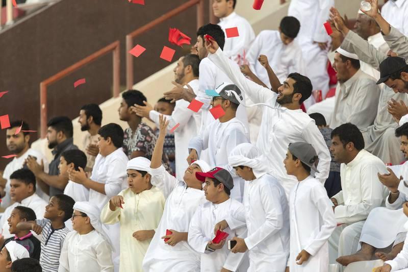 Fujairah, United Arab Emirates, November 4, 2017:    Supporters of Fujairah football club celebrate scoring against Al Orouda during their UAE first division regular season match at the Fujairah stadium in Fujairah on November 4, 2017. Christopher Pike / The National  Reporter: John McAuley Section: Sport