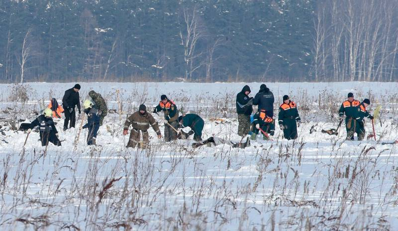 Russian Emergency Situations Ministry members work at the crash site of the short-haul AN-148 airplane operated by Saratov Airlines in Moscow Region, Russia February 12, 2018. REUTERS/Tatyana Makeyeva