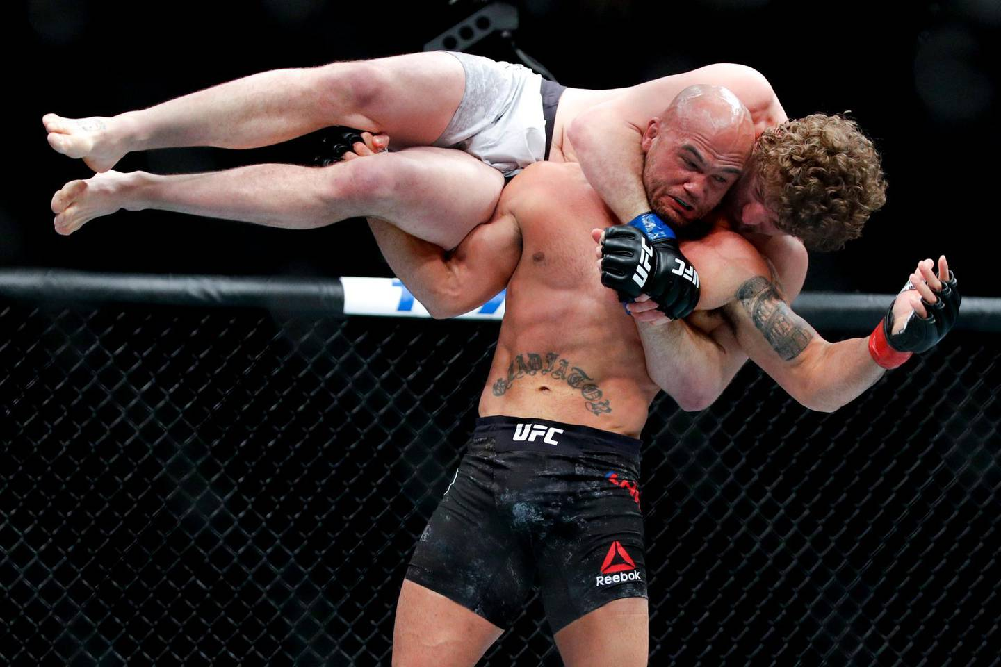 Robbie Lawler picks up Ben Askren in a welterweight mixed martial arts bout at UFC 235, Saturday, March 2, 2019, in Las Vegas. (AP Photo/John Locher)