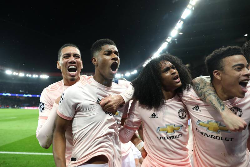 PARIS, FRANCE - MARCH 06: Marcus Rashford of Manchester United celebrates after scoring his sides third goal with teammates Chris Smalling and Tahith Chong during the UEFA Champions League Round of 16 Second Leg match between Paris Saint-Germain and Manchester United at Parc des Princes on March 06, 2019 in Paris, . (Photo by Julian Finney/Getty Images)