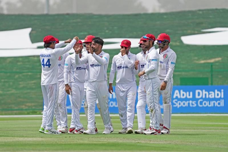 Afghanistan celebrate after Rashid Khan dismissed Zimbabwe's Tarisai Musakanda. Courtesy Abu Dhabi Cricket