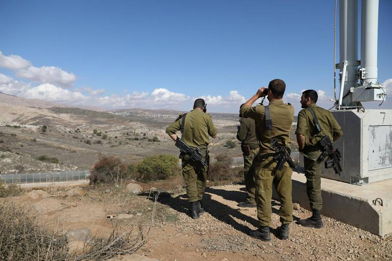 Israeli forces are seen near a border fence between the Israeli-occupied side of the Golan Heights and Syria, November 4, 2017. REUTERS/Ammar Awad