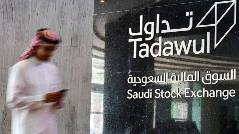(FILES) This file photo taken on December 12, 2019, shows a view of the sign showing the logo of Saudi Arabia's Stock Exchange Market (Tadawul) bourse in the capital Riyadh. Saudi's stock exchange fell 6.5 percent, shares in oil giant Saudi Aramco dropped below their IPO price for their first time, and other Gulf markets tumbled to multi-year lows at the start of trading after OPEC and its allies failed to clinch a deal over oil production cuts. / AFP / FAYEZ NURELDINE