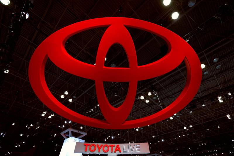 epa06636387 The Toyota logo looms high above the showroom floor during the media preview day two at the New York International Auto Show at the Jacob K. Javits Center in New York City, New York, USA, 29 March 2018. The show is open to the public from 30 March until 08 April 2018.  EPA/PETER FOLEY