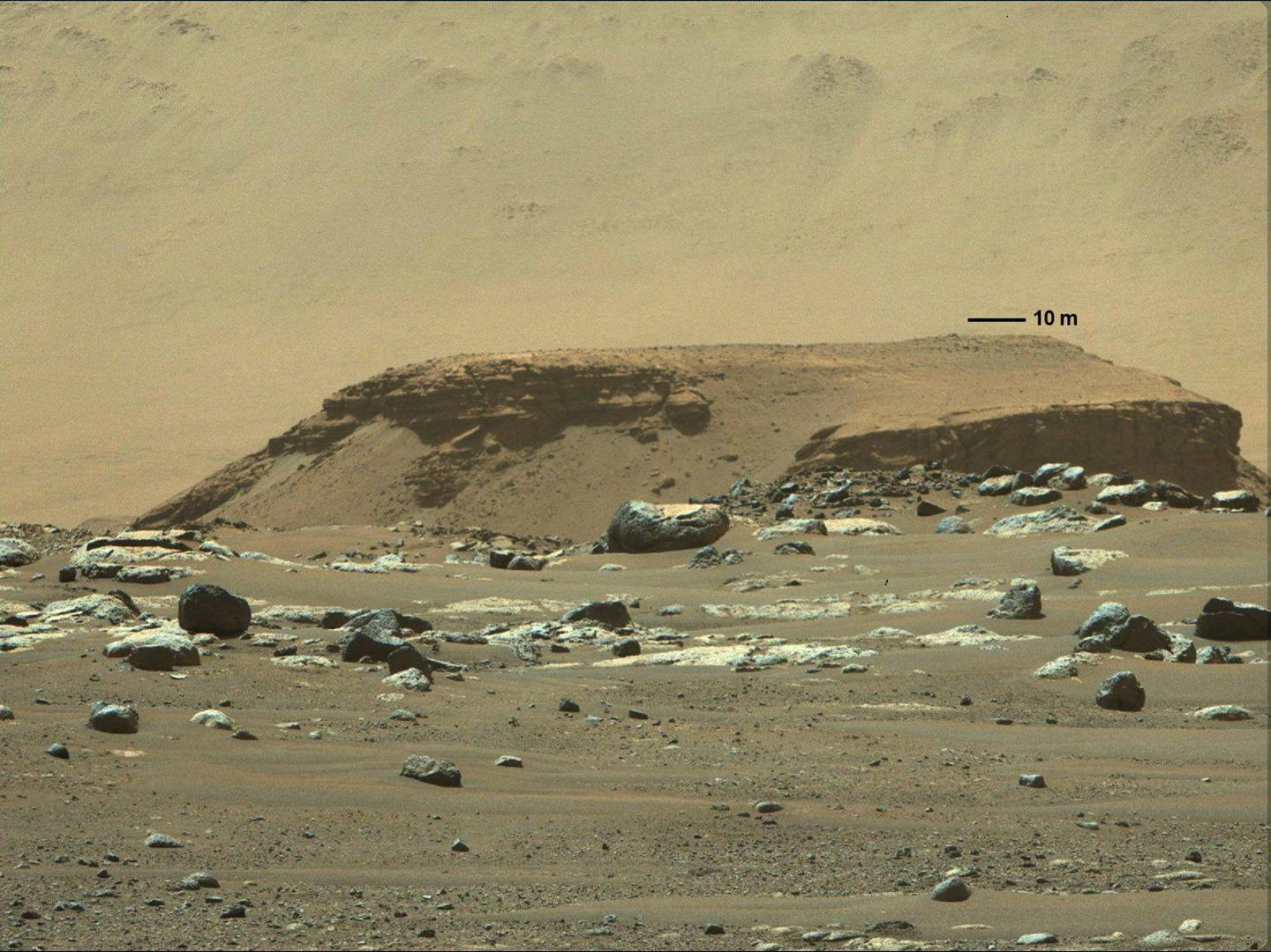 A tall outcropping of rock, with layered deposits of sediments in the distance, marking a remnant of an ancient, long-vanished river delta in Jezero Crater, are pictured in this undated image taken by NASA's Mars rover Perseverance from its landing site, and supplied to Reuters on March 5, 2021. NASA/JPL-Caltech/Handout via REUTERS MANDATORY CREDIT. THIS IMAGE HAS BEEN SUPPLIED BY A THIRD PARTY. MANDATORY CREDIT