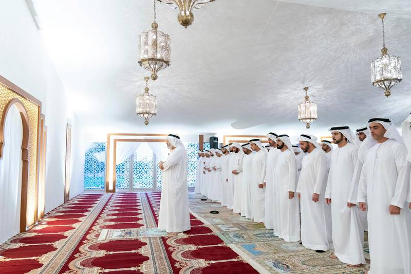 DUBAI, UNITED ARAB EMIRATES - May 19, 2019: HH Sheikh Mohamed bin Zayed Al Nahyan, Crown Prince of Abu Dhabi and Deputy Supreme Commander of the UAE Armed Forces (front row 5th R), prays after an iftar reception hosted by HH Sheikh Mohamed bin Rashid Al Maktoum, Vice-President, Prime Minister of the UAE, Ruler of Dubai and Minister of Defence ( front row 4th L), at Zabeel Palace. Seen with (front R-L) HH Lt General Sheikh Saif bin Zayed Al Nahyan, UAE Deputy Prime Minister and Minister of Interior, HH Sheikh Hamdan bin Mohamed Al Maktoum, Crown Prince of Dubai and HH Sheikh Hamdan bin Zayed Al Nahyan, Ruler's Representative in Al Dhafra Region.  ( Mohamed Al Hammadi / Ministry of Presidential Affairs ) ---