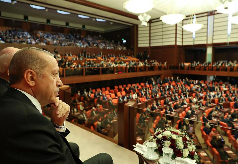 Turkey's President Recep Tayyip Erdogan attends opening session of the new parliament in Ankara, Turkey, Saturday, July 7, 2018 following last month's elections that have shifted more power to the presidency. Turkey's governing system is changing from a parliamentary system to an executive presidency, which abolishes the office of the prime minister and changes parliament's responsibilities. (Presidency Press Service via AP, Pool)