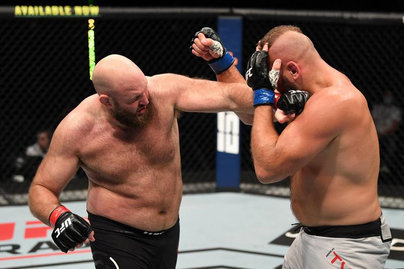 ABU DHABI, UNITED ARAB EMIRATES - OCTOBER 11: In this handout image provided by UFC,  (L-R) Ben Rothwell punches Marcin Tybura of Poland in their heavyweight bout during the UFC Fight Night event inside Flash Forum on UFC Fight Island on October 11, 2020 in Abu Dhabi, United Arab Emirates. (Photo by Josh Hedges/Zuffa LLC via Getty Images)