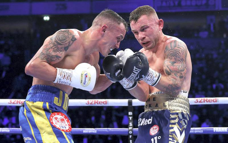 MANCHESTER, ENGLAND - DECEMBER 22:  Josh Warrington and Carl Frampton exchange punches during the IBF World Featherweight Championship title fight between Josh Warrington and Carl Frampton at Manchester Arena on December 22, 2018 in Manchester, England.  (Photo by Alex Livesey/Getty Images)