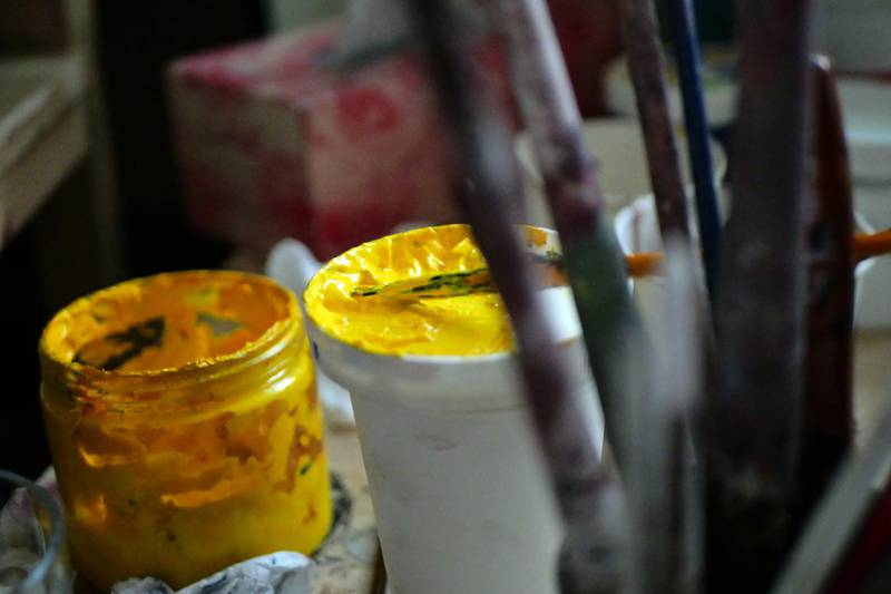 Pictured: Art supplies including a paintbrush and paint pot at the ArtLords headquarters in Kabul.Photo by Charlie Faulkner February 2021