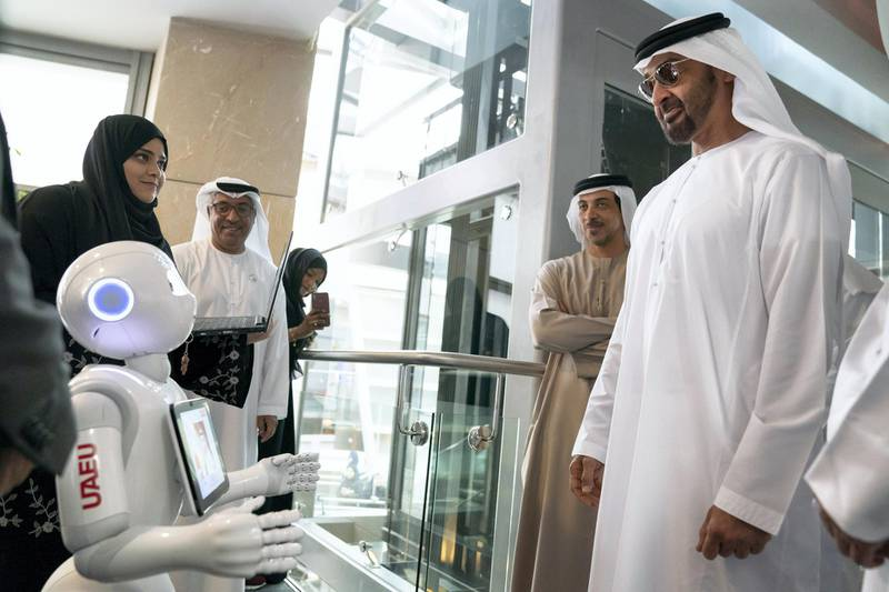 AL AIN, ABU DHABI, UNITED ARAB EMIRATES - February 07, 2019: HH Sheikh Mohamed bin Zayed Al Nahyan, Crown Prince of Abu Dhabi and Deputy Supreme Commander of the UAE Armed Forces (R),looks at a robots, during a visit to the United Arab Emirates University. Seen with HH Sheikh Mansour bin Zayed Al Nahyan, UAE Deputy Prime Minister and Minister of Presidential Affairs (2nd R). ( Mohamed Al Hammadi / Ministry of Presidential Affairs ) ---