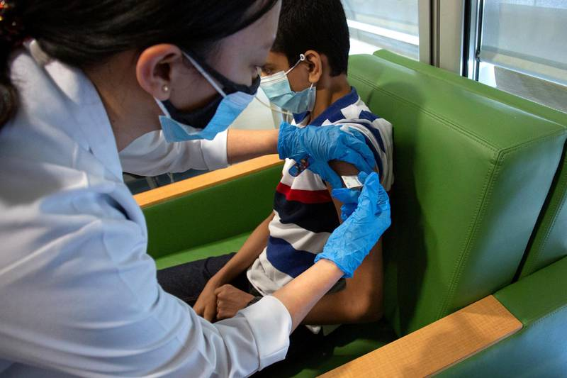 12-15 year olds receiving the Covid-19 Pfizer-BioNTech vaccine. Courtesy Dubai Media Office