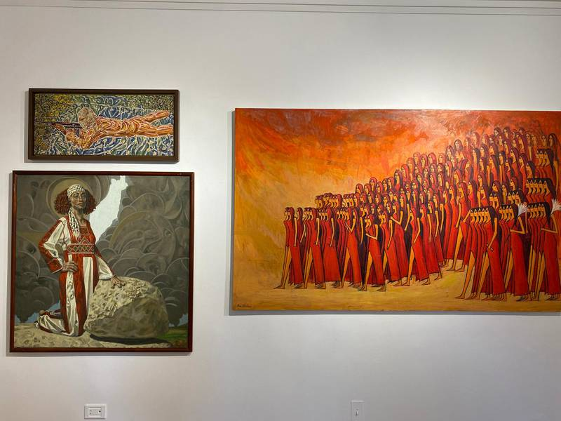 The artwork for sale includes a 1970 piece by Injy Efflatoun (top left), Walid Ebeid's 'Unruly Palestine' (bottom left) and Alaa Awad's 'The Farewell' (right). Nada El Sawy / The National