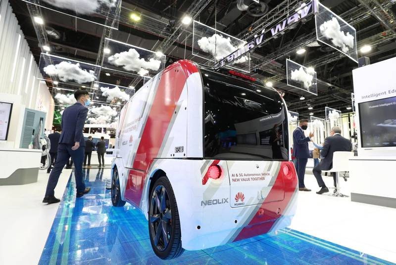 Dubai, United Arab Emirates - December 06, 2020: A visitor walks passed the AI & 5G Autonomous Vehicle from Huawei during GITEX 2020 at the World Trade Centre. December 6th, 2020 in Dubai. Chris Whiteoak / The National