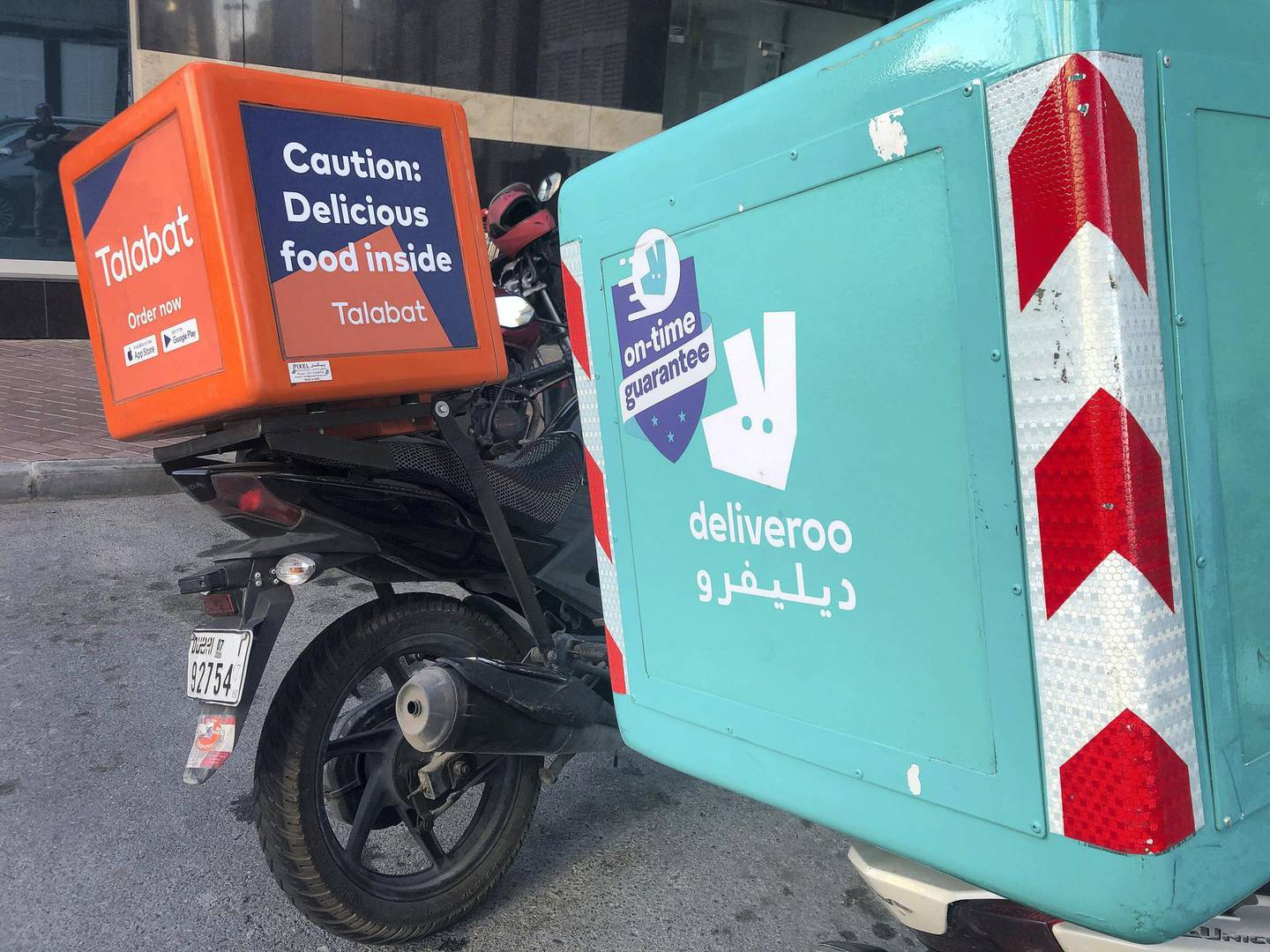 Dubai, United Arab Emirates - Reporter: N/A: Stock. General view of takeaway Talabat and Deliveroo bikes. Tuesday, 18th of February, 2020. JLT, Dubai. Chris Whiteoak / The National