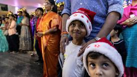 Tens of thousands flock to Dubai mega church for midnight Mass – in pictures