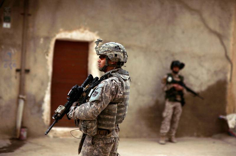 Mandatory Credit: Photo by Maya Alleruzzo/AP/Shutterstock (7049094a)An Iraqi Army soldier and a U.S. Army soldiers from Delta Co., 1st Combined Arms Battalion, 67th Armor Regiment stand guard during a joint patrol in Mosul, 360 kilometers (225 miles) northwest of Baghdad, Iraq. Two U.S. soldiers were killed, by an Iraqi trooper who opened fire on them during a training exercise Saturday, raising fresh concerns about Iraq's security forces as the Americans prepare to withdraw from the country by the end of this year. Another soldier was killed Saturday during a military operation in central Iraq, making it one of the deadliest days for U.S. forces in the country in monthsIraq US Troops, MOSUL, Iraq