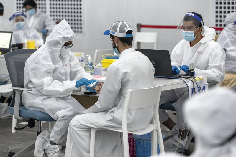 ABU DHABI, UNITED ARAB EMIRATES. 05 AUGUST 2020. The DPI Screening facility along the border between Dubai and Abu Dhabi which screens travellers for the COVID-19 virus using a blood sample and laser technology. It is a quick blood test and results are out in a matter of minutes. (Photo: Antonie Robertson/The National) Journalist: Nick Webster. Section: National.