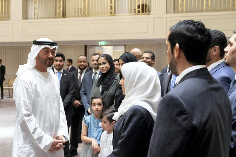BERLIN, GERMANY - June 12, 2019: HH Sheikh Mohamed bin Zayed Al Nahyan, Crown Prince of Abu Dhabi and Deputy Supreme Commander of the UAE Armed Forces (L), speaks with Emirati students who are studying in Germany.  (Eissa Al Hammadi / For the Ministry of Presidential Affairs )