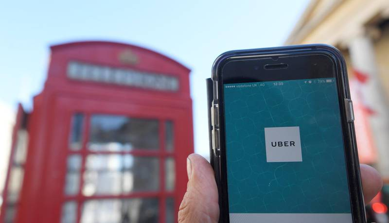 A photo illustration shows the Uber app logo displayed on a mobile telephone, as it is held up for a posed photograph in central London September 22, 2017. REUTERS/Toby Melville