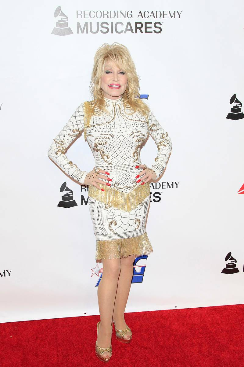 epa07354423 US singer/songwriter Dolly Parton arrives for the 2019 MusiCares Person of the Year Tribute in Los Angeles, California, USA 08 February 2019. MusiCares Person of the Year Tibute honored US musician Dolly Parton for her extraordinary creative accomplishments and significant charitable work.  EPA-EFE/NINA PROMMER