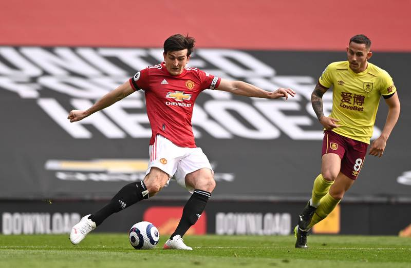 MANCHESTER, ENGLAND - APRIL 18: Harry Maguire of Manchester United in action during the Premier League match between Manchester United and Burnley at Old Trafford on April 18, 2021 in Manchester, England. Sporting stadiums around the UK remain under strict restrictions due to the Coronavirus Pandemic as Government social distancing laws prohibit fans inside venues resulting in games being played behind closed doors. (Photo by Laurence Griffiths/Getty Images)
