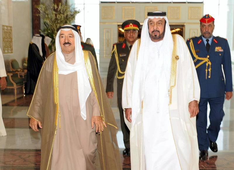 epa02483155 A handout picture released by Emirates News Agency (WAM) shows United Arab Emirates President Sheikh Khalifa bin Zayed Al Nahyan (R) walks with His Highness the Amir of the State of Kuwait Sheikh Sabah Al-Ahmad Al-Jaber Al-Sabah (L), during his arrival to Abu Dhabi to attend the GCC Summit, United Arab Emirates, 06 December 2010.  EPA/EMIRATES NEWS AGENCY / HANDOUT  EDITORIAL USE ONLY *** Local Caption *** 02483155