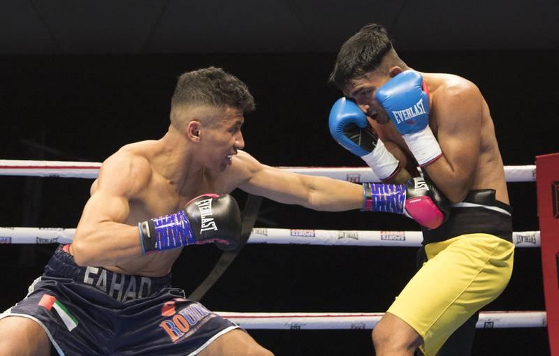 Dubai, United Arab Emirates - Emirati boxer Fahad Al Bloushi (left) boxing with Suraj from India at the Rotunda, Ceasar's Palace, Bluewaters Island, Dubai.  Leslie Pable for The National