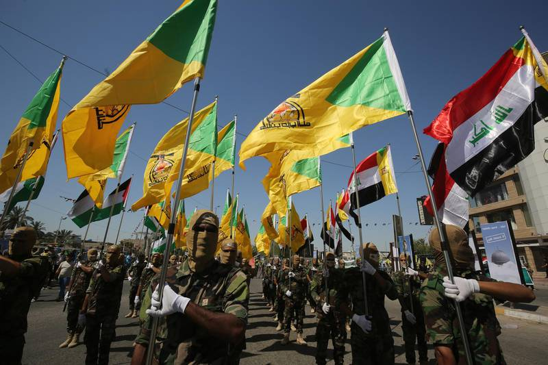 Iraqi Shiite fighters from the Iran-backed armed group, Hezbollah brigades, march during a military parade marking Al-Quds (Jerusalem) International Day in Baghdad, on May 31, 2019. - An initiative started by the late Iranian revolutionary leader Ayatollah Ruhollah Khomeini, Quds Day is held annually on the last Friday of the Muslim fasting month of Ramadan and calls for Jerusalem to be returned to the Palestinians . (Photo by AHMAD AL-RUBAYE / AFP)