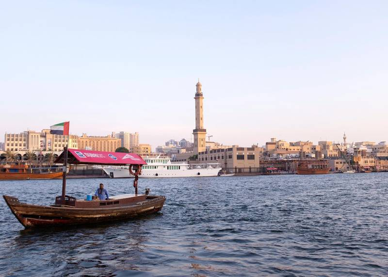 DUBAI, UNITED ARAB EMIRATES - JULY 10 2019.Dhows unloading and loading items by Deira's Spice Market.For many people, the creek (Khor) with its dhow moorings, abra water taxis, and souks is the very essence of the old city - the place where many things have started. For decades, Dubai Creek has been a hub of activity as traders bring in goods and sell their wares at the bustling markets nearby. Photo by Reem Mohammed/The National)Reporter: JOHN DENNEHYSection: