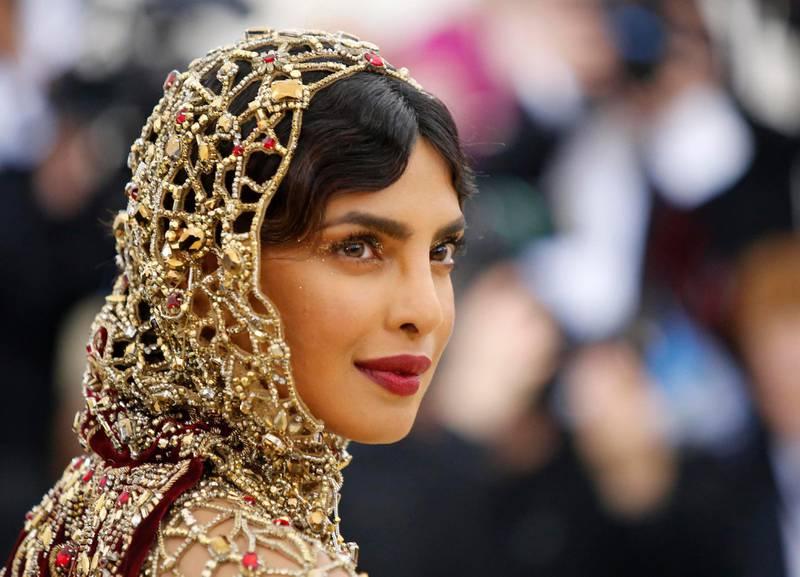 "Actress Priyanka Chopra arrives at the Metropolitan Museum of Art Costume Institute Gala (Met Gala) to celebrate the opening of ""Heavenly Bodies: Fashion and the Catholic Imagination"" in the Manhattan borough of New York, U.S., May 7, 2018. REUTERS/Eduardo Munoz"