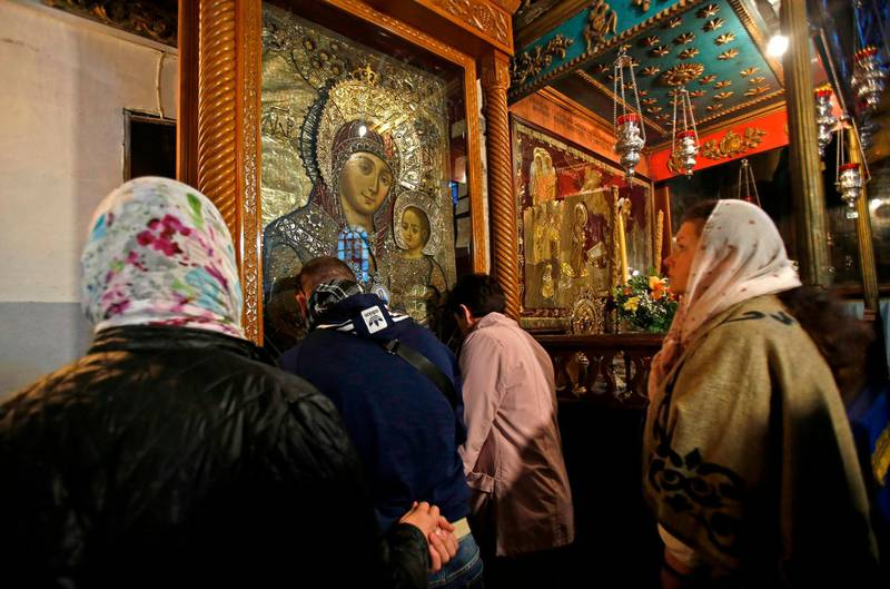Christian pilgrims visit the Church of the Nativity, the site where Christians believe Jesus was born, in the biblical West Bank city of Bethlehem on December 24, 2019.  / AFP / Musa Al SHAER