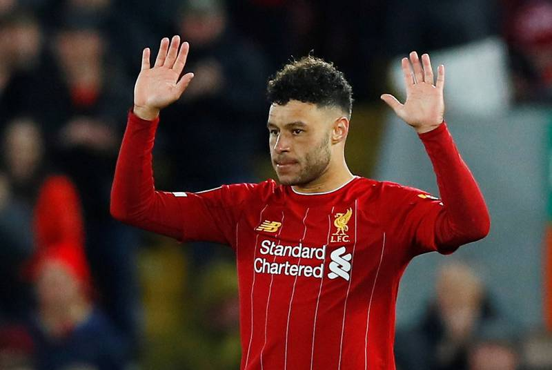 """Soccer Football - Carabao Cup - Fourth Round - Liverpool v Arsenal - Anfield, Liverpool, Britain - October 30, 2019  Liverpool's Alex Oxlade-Chamberlain celebrates scoring their third goal  Action Images via Reuters/Jason Cairnduff  EDITORIAL USE ONLY. No use with unauthorized audio, video, data, fixture lists, club/league logos or """"live"""" services. Online in-match use limited to 75 images, no video emulation. No use in betting, games or single club/league/player publications.  Please contact your account representative for further details."""