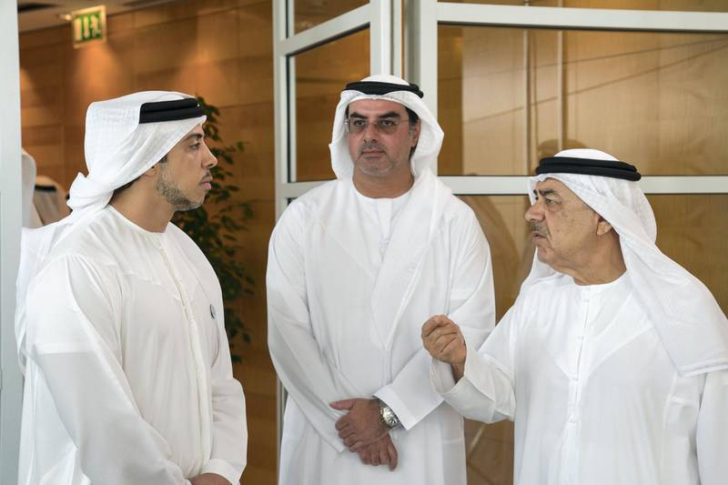 ABU DHABI, UNITED ARAB EMIRATES -  March 07, 2018: HH Sheikh Mansour bin Zayed Al Nahyan, UAE Deputy Prime Minister and Minister of Presidential Affairs (L), HH Sheikh Mohamed bin Khalifa Al Nahyan, Abu Dhabi Executive Council Member (C), and HE Khalil Mohamed Sharif Foulathi (R), speak prior to a board meeting at the Abu Dhabi Investment Authority (ADIA).  ( Ryan Carter for the Crown Prince Court - Abu Dhabi ) ---