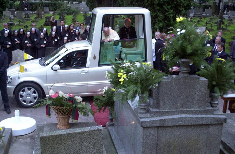 KRAKOW - AUGUST 18:  Pope John Paul II stands in a popemobile which is parked in front of his family tomb August 18 , 2002 in Krakow-Rakovice, Poland. The Pope is in his homeland on the third day of his four-day visit, the ninth during his pontificate.  (Photo by Franco Origlia/Getty Images)