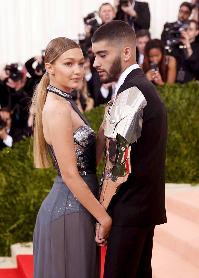 """FILE PHOTO: Model Gigi Hadid (L) and singer Zayn Malik arrive at the Metropolitan Museum of Art Costume Institute Gala (Met Gala) to celebrate the opening of """"Manus x Machina: Fashion in an Age of Technology"""" in the Manhattan borough of New York, May 2, 2016. REUTERS/Eduardo Munoz/File Photo"""