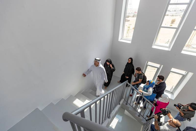Dubai, United Arab Emirates - October 23, 2019: Dawoud Al Hajri, Director General of Dubai Municipality takes people on a tour. The opening of the largest 3D printed two-story structure in the world. Wednesday the 23rd of October 2019. Warsan, Dubai. Chris Whiteoak / The National